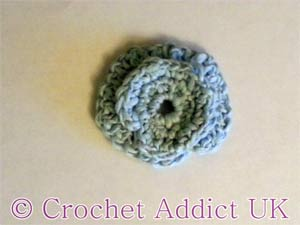 Curl and Swirl Button Flower free crochet pattern
