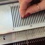 inserting knitting machine needle